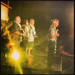 Master Navigator and Hokuleia captain Nainoa Thompson accepts his award, while the Aikau family stands behind him.